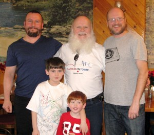 (7) From left to right: my son, Marc, me, and my son, Eric. plus Éric's two sons, Maxime and Sébastien (the red head).