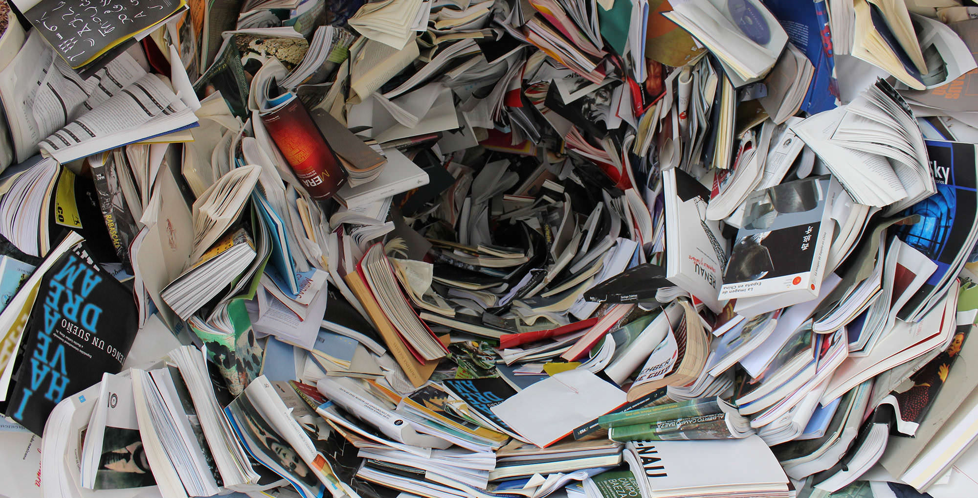 Enormous number of books swirling inwards like a whirlpool - what huge scoping reviews must be like!