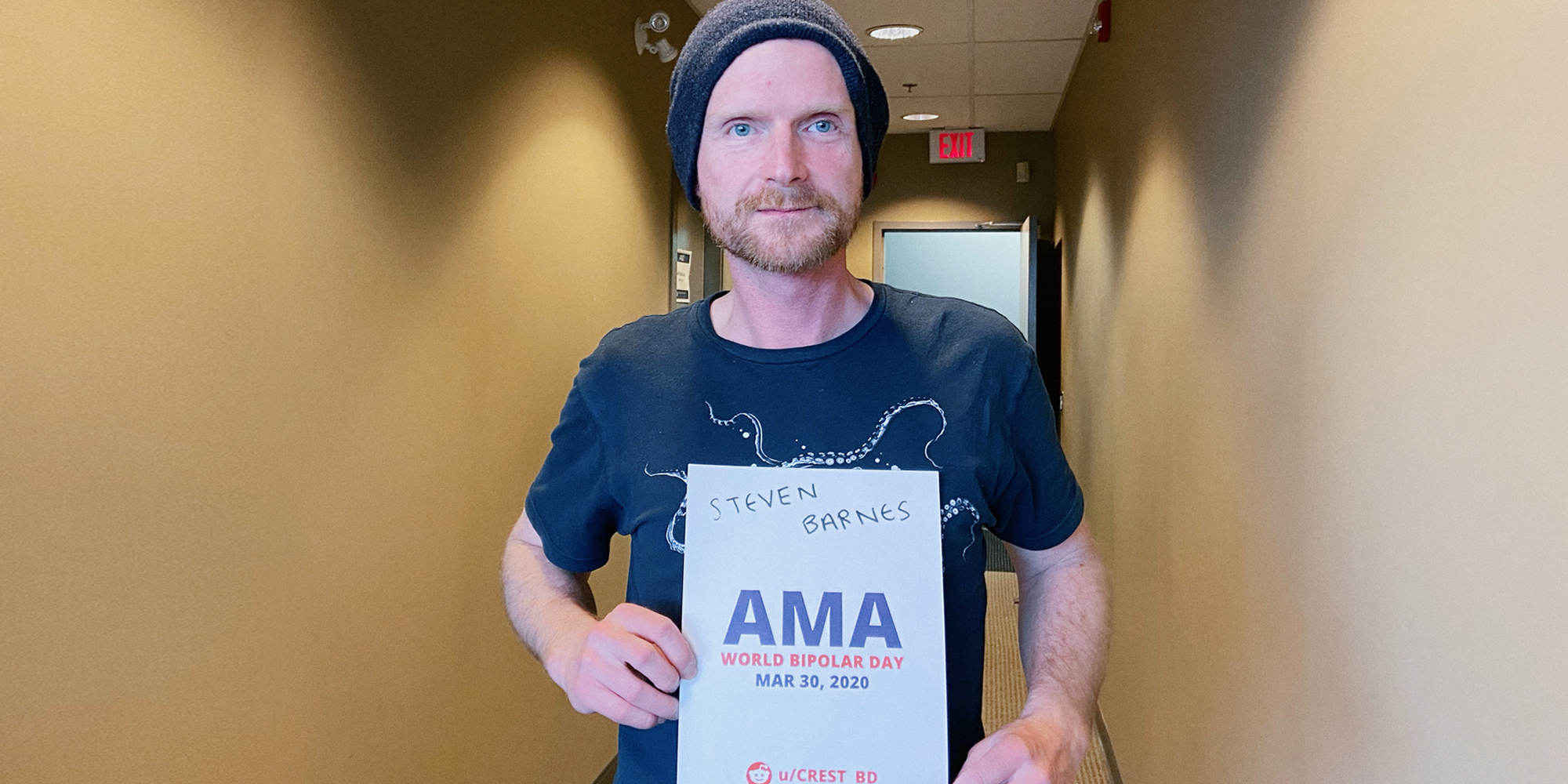 Dr. Barnes holding a sign proving he will be involved in the bipolar ama.