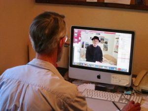 Bruce faced away from the camera, editing a video clip of Bob Choma, the man featured in Chomavision.